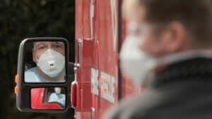 Ambulance Care Driver wore Sun May SM-3101 prevent COVID-19 spread Src-Life care center of Kirkland